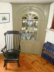Early 18th century corner cabinet in the Macy-Colby House